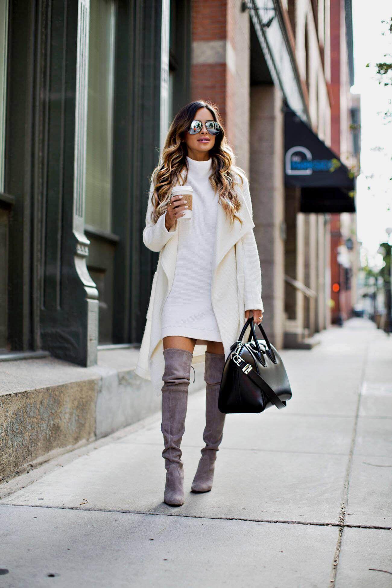 look con vestidos cortos y botas largas para una posada en invierno