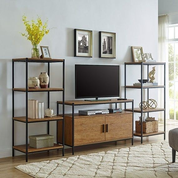 Cómo decorar con madera y metal el área de la televisión
